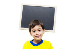 Little boy holding a blackboard Royalty Free Stock Images