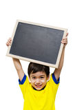 Little boy holding a blackboard Royalty Free Stock Image