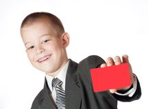 Little boy holding a blank Royalty Free Stock Photo