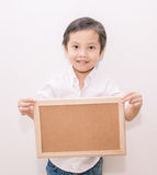 Little boy holding a board Stock Image