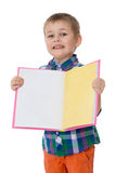 Little boy holding a book Royalty Free Stock Photo