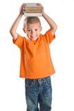 Little Boy holding books stock image