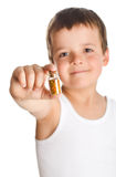 Little boy holding bottle with pollen - isolated Stock Image