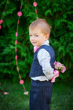 Little boy holding a bouquet of flowers behind his back Royalty Free Stock Photos