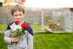 Little boy holding a bouquet of roses Royalty Free Stock Photography