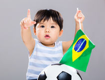 Little boy holding Brazil flag and soccer ball Royalty Free Stock Images