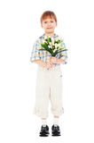 Little boy holding bunch of tulips royalty free stock photos