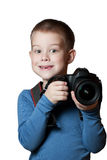 Little Boy holding camera and taking photo Stock Photos