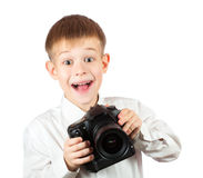 Little Boy is holding camera and taking a photo Stock Photography
