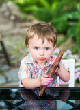 Little Boy Holding a Chocolate Bunny Royalty Free Stock Photo