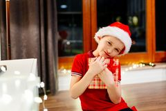 Little boy holding a Christmas gift Stock Photography