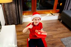 Little boy holding a Christmas gift Stock Images