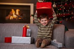 Little boy holding christmas present Royalty Free Stock Photo