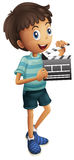 Little boy holding clapboard Royalty Free Stock Images