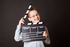 Little boy holding clapper board in hands. Stock Image