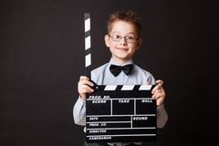 Little boy holding clapper board in hands. Stock Photo