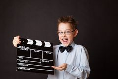 Little boy holding clapper board in hands. Stock Images