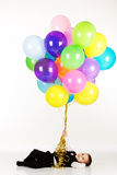 Little boy holding colorful balloons Royalty Free Stock Image