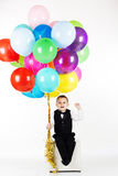 Little boy holding colorful balloons Royalty Free Stock Photo