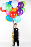 Little boy holding colorful balloons Royalty Free Stock Photos