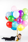 Little boy holding colorful balloons Royalty Free Stock Photography