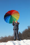 Little boy holding colorful umbrella in winter Royalty Free Stock Photo