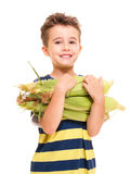 Little boy holding corn on the cob Royalty Free Stock Image