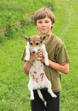 Little boy holding a dog Royalty Free Stock Photography