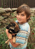Little boy holding a dog Royalty Free Stock Images
