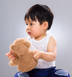 Little boy holding doll bear Royalty Free Stock Image