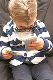 Little boy holding dollar bills stock image