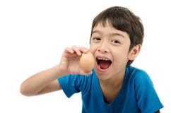 Little boy holding egg in hand healthy on white background Royalty Free Stock Photos