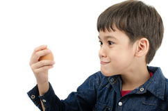 Little boy holding egg in hand healthy on white background Royalty Free Stock Photography