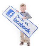 Little boy holding Facebook sign Stock Images