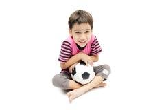 Little boy holding football sport player. Little boy holding football on white background Royalty Free Stock Photos