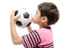 Little boy holding football sport player Royalty Free Stock Image