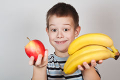 Little Boy holding fruit Royalty Free Stock Photography