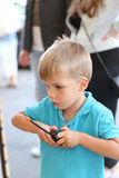 Little boy holding a gaming controller Royalty Free Stock Photo