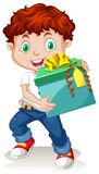 Little boy holding a gift box Royalty Free Stock Image