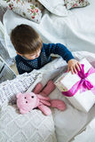Little boy holding a gift Stock Images