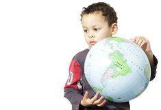 Little boy holding a globe stock images