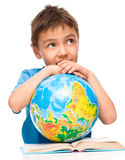 Little boy is holding globe Royalty Free Stock Image