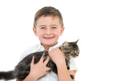 Little boy holding grey kitten smiling at camera Stock Image
