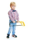Little boy holding a hacksaw. Royalty Free Stock Image