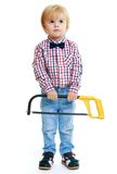 Little boy holding a hacksaw. Royalty Free Stock Photos