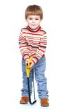 The little boy is holding a hacksaw Royalty Free Stock Image