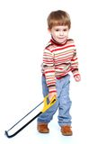 Little boy holding a hacksaw Royalty Free Stock Photos
