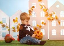 Little Boy Holding Halloween Pumpkin Royalty Free Stock Image