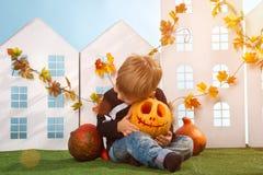 Little Boy Holding Halloween Pumpkin Royalty Free Stock Photography