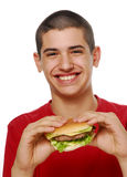 Little boy holding hamburger. Stock Image